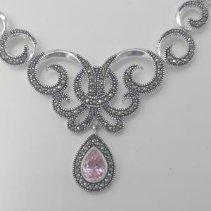 Necklace, scrolled marcasite with pink stone